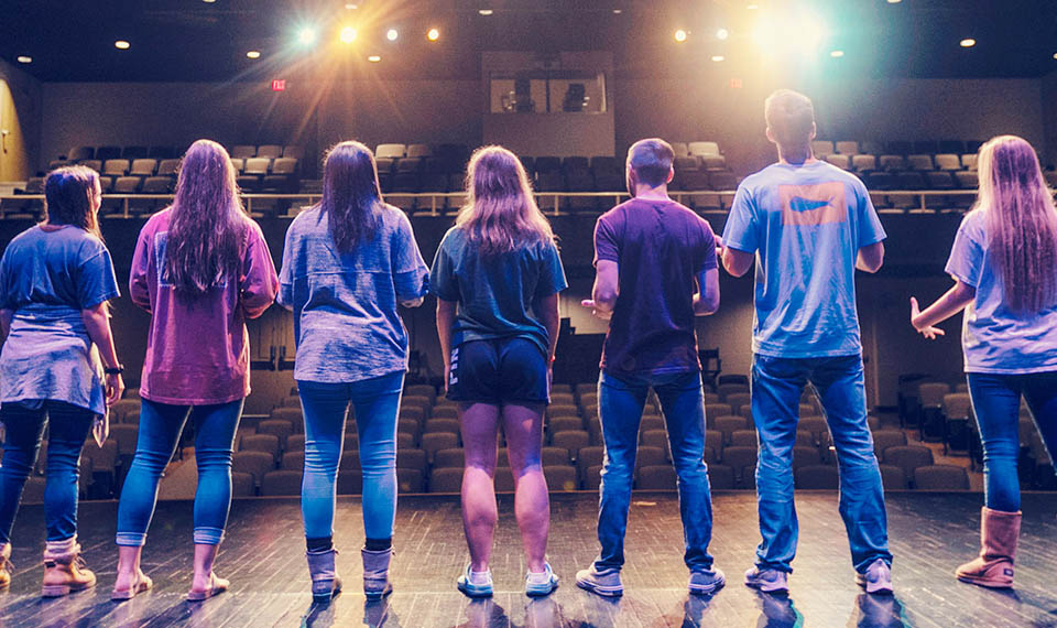 Students on stage in the McCain Theater