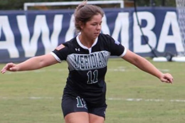 Kristin Robertson kicking soccer ball