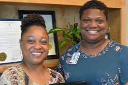 Rhonda Smith, left, with Jamila Brown Coleman. Smith was selected as South Mississippi Adult Education Support Staff Person of the Year.